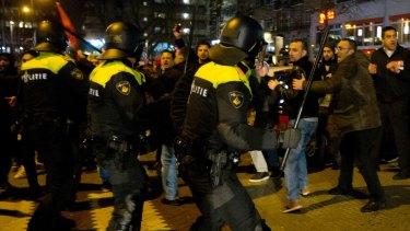 Dutch riot police battle pro-Erdogan demonstrators  outside the Turkish consulate in Rotterdam on Sunday.