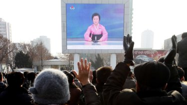 North Koreans watch a news broadcast on a video screen outside Pyongyang Railway Station in North Korea on Wednesday.