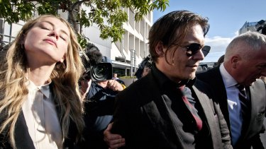 Johnny Depp leaving court with his wife Amber Heard.