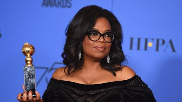 Oprah Winfrey poses in the press room with the Cecil B. DeMille Award at the 75th annual Golden Globe Awards at the Beverly Hilton Hotel on Sunday, Jan. 7, 2018, in Beverly Hills, California.