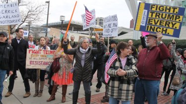 Indivisible supporters rally in Balitmore in February.