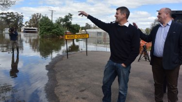 Premier Mike Baird visits flooded Forbes on Monday.
