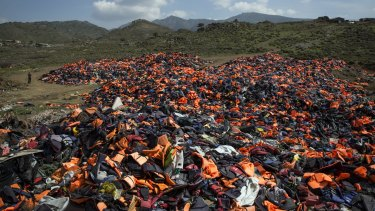 A pile of thousands of discarded life vests  dumped in a valley in hills above the town of Mithymna on Lesbos, Greece, on Monday.
