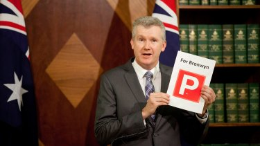 "Labor finance spokesman Tony Burke waving a print of a ""P"" plate for Speaker Bronwyn Bishop."