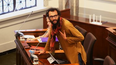 Cr Jonathan Sri also frequently wears scarves in the Brisbane City Council chamber.