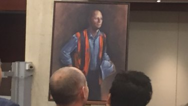 Campbell Newman and wife Lisa look on as the portrait is unveiled.