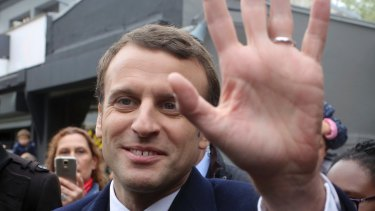 Centrist candidate Emmanuel Macron waves to supporters.
