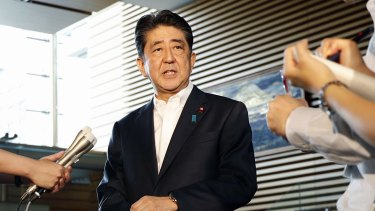 Japanese Prime Minister Shinzo Abe speaks to journalists  after North Korea's firing of a missile over Japan on Tuesday.