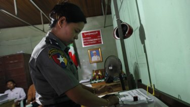 A Myanmar police officer votes in Naypyitaw on Thursday ahead of the November 8 general elections.