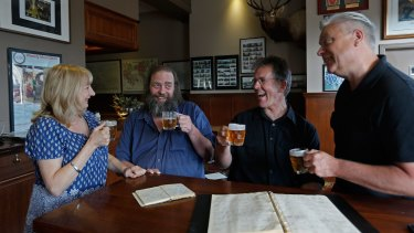 Llewella Bates, Mick Stevens, Stuart McArthur and Tim Dorgan toast the end of their pub crawl at the Clyde Hotel in Carlton on Saturday.