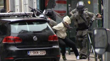 The moment Abdeslam was bundled into a car by police last week.