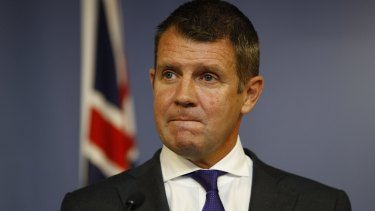 NSW Premier Mike Baird announces his retirement at a press conference on Thursday.