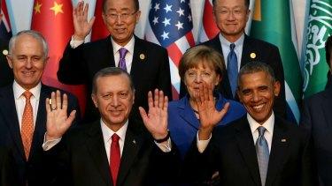 From left: Australian Prime Minister Malcolm Turnbull, Turkish President Recep Tayyip Erdogan, UN Secretary General Ban ki-Moon, German Chancellor Angela Merkel, World Bank President Jim Yong Kim, U.S. President Barack Obama during the G-20 summit, in Antalya, Turkey, Sunday, November 15, 2015.