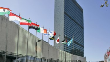 Flags of member nations flying outside United Nations headquarters in New York.
