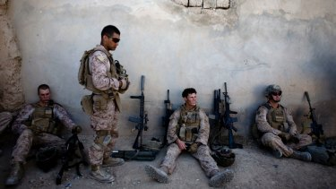 US Marines take a break during a patrol in Sangin, south of Kabul, Afghanistan, in 2011.