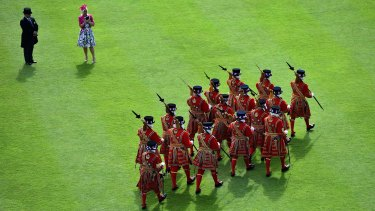 Yeomen of the Guard march during the garden party in the grounds of Buckingham Palace on Thursday.