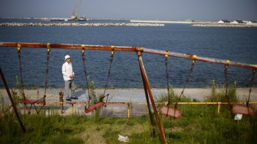 Yoshiteru Kohata at a seaside playground damaged by the 2011 earthquake and tsunami, in his birthplace of Soma, Fukushima.