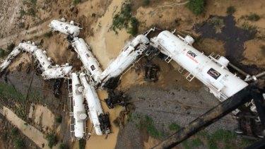 An Aurizon freight train lies beside the tracks after derailing near Julia Creek in Queensland's north-west.