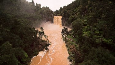 Hunua Falls in peak flow during heavy rain after the tail end of Cyclone Debbie lands in New Zealand.