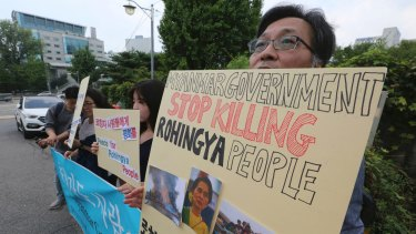 Human right activists protest against the ethnic cleansing of the Rohingya Muslim minority.