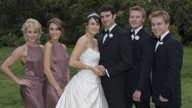 Rosetta (Natalie Saleeba) and Frazer (Ben Lawson) get married in <i>Neighbours</i>.