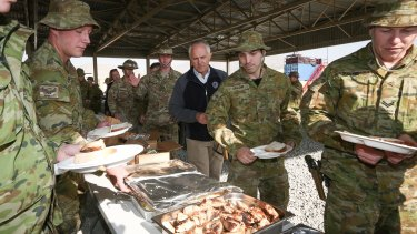 Prime Minister Malcolm Turnbull meets with ADF trainers and force protection troops during a barbecue lunch at the Afghanistan National Army Officer Academy in Kabul.