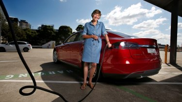 Tesla electric car owner Sally Perini, at a charging station on top of Westfield Chatswood.