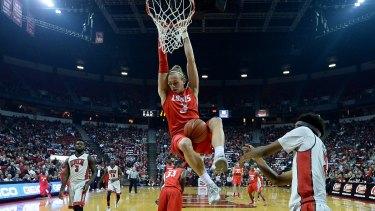 Jam session: Hugh Greenwood dunks for New Mexico against UNLV in Las Vegas.