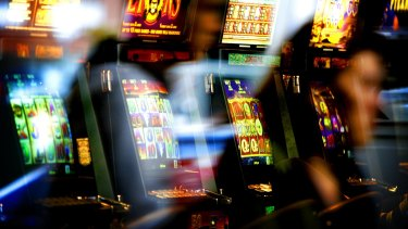 The Greens are pushing for a reduction in the number of poker machines clubs can have on site.