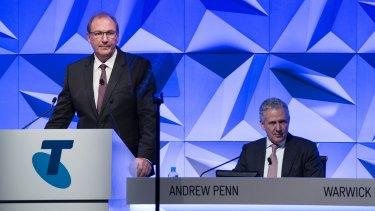 Telstra chairman John Mullen (left) flagged the dividend cut.
