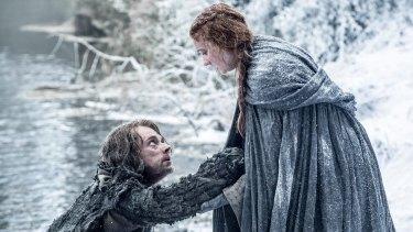 Alfie Allen as Theon Greyjoy and Sophie Turner as Sansa Stark.