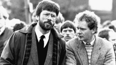 Sinn Fein president Gerry Adams, left, stands with Martin McGuinness at the funeral of an Irish Republican Army commander in Dungannon, Northern Ireland, in May 1987.