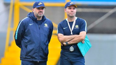 Ange Postecoglou (left) and his assistant Ante Milicic watch the Australian players train.
