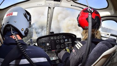 Wayne Rigg in a CFA helicopter with pilot Kyhala Miller.
