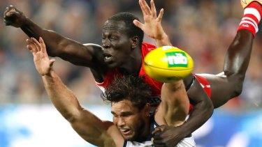 Sydney Swan Aliir Aliir flies over Tom Hawkins in their win against Geelong in round 16.