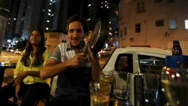 A man hits pans at a Sao Paulo bar in protest against the speech of Brazilian President Dilma Rousseff, broadcast on television.