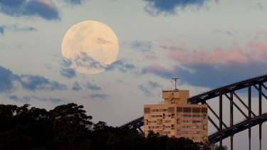 A supermoon rises over Sydney Harbour in August 2014.