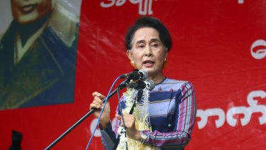 Myanmar Opposition Leader Aung San Suu Kyi speaks during her 'Election Awareness Tour' in Ho-Pong township, Myanmar on Sunday.