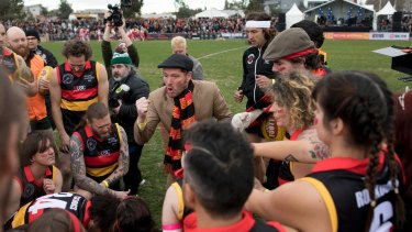 A bit of theatre: Reclink Community founder Jason Evans revs up the Rockdogs team at Victoria Park on Sunday.
