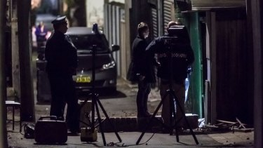 Police at the scene of the raid in Surry Hills on Saturday.