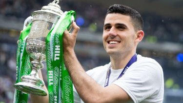 Hero: Tom Rogic lifts the Scottish Cup after scoring the injury-time winner for Celtic against Aberdeen.