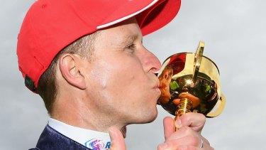 Winner: Kerrin McEvoy kisses the Melbourne Cup.
