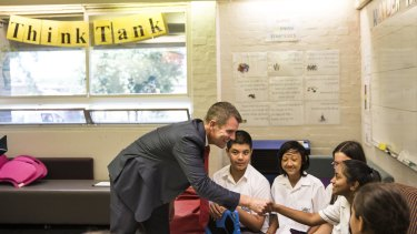 Premier Mike Baird with students at Casula High School on Thursday.