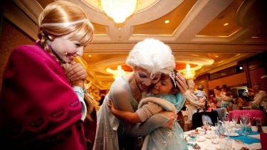 Three-year-old Samara Muir, who was racially vilified at a Disney <i>Frozen</i> event in May, attends a Melbourne high tea to meet the Norwegian sisters she adores, 'Anna' and 'Elsa'.