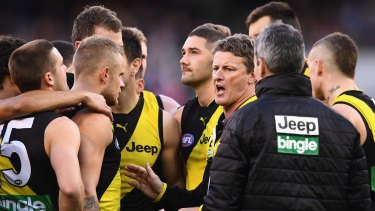 Game plan: Tigers coach Damien Hardwick talks to his players.