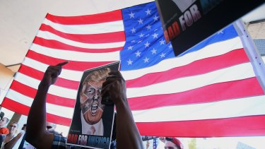 A protester with an anti-Donald Trump sign in Tucson, Arizona, on Saturday.