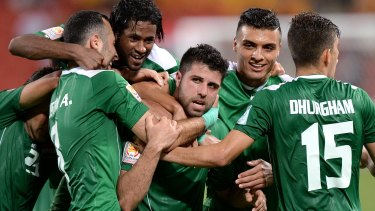 Iraq's Yaser Kasim is mobbed by his teammates after scoring what turned out to be the lone goal of the match.