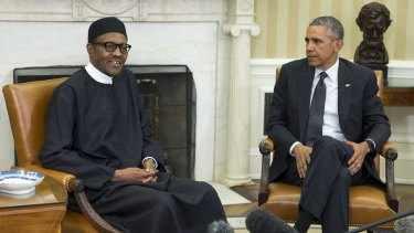 US President Barack Obama, right,  with Nigerian President Muhammadu Buhari in the Oval Office of the White House on Monday.