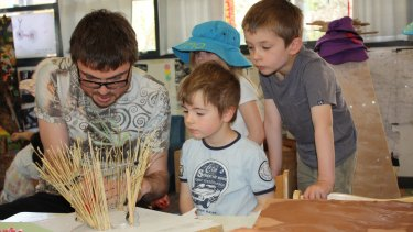 Ben Statkus with young designers at work on the Swinburne cubby.