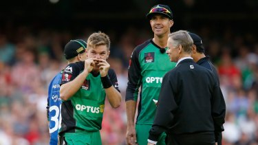 Adam Zampa holds his nose as he looks up at a replay of the bizarre run-out in which he was involved on Saturday night.